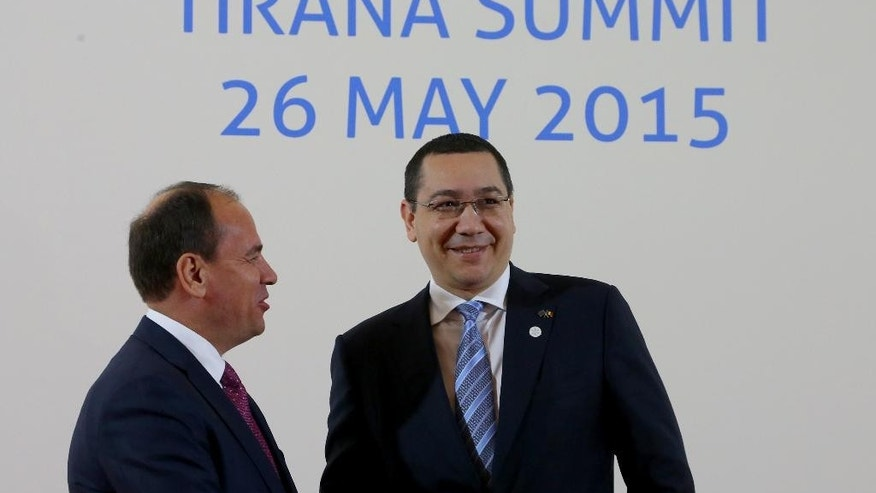 Albanian President Bujar Nishani, left, meets with visiting Romanian Prime Minister Victor Ponta in Tirana, Tuesday May 26, 2015, during the South East European Cooperation Process summit, a regional grouping of 13 Balkan and eastern European countries. (AP Photo/Hektor Pustina)