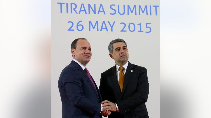 Albanian President Bujar Nishani, left, meets with visiting Bulgarian President Rosen Plevneliev in Tirana, Tuesday May 26, 2015, during the South East European Cooperation Process summit, a regional grouping of 13 Balkan and eastern European countries. (AP Photo/Hektor Pustina)