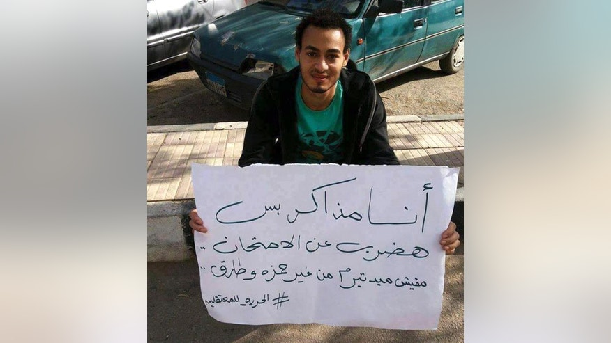 In this November 25, 2013 photo provided by a friend of Islam Ateto, engineering student Islam Ateto holds a sign protesting the arrest of fellow students at Ain Shams University, in Cairo, Egypt. Egyptian authorities are investigating the killing of Ateto by police, a judicial official said Tuesday, May 26, 2015, the latest in series of cases alleging brutality by security forces. The death of Ateto on May 19, has become a major topic on Egyptian television talk shows and in newspapers in recent days, as his family and colleagues say he was last seen alive in class taking an exam. Security officials, meanwhile, have insisted Ateto was an Islamic militant belonging to the outlawed Muslim Brotherhood group and was wanted over the killing of a police officer last month. (Photo courtesy of a friend of Islam Ateto, via AP)