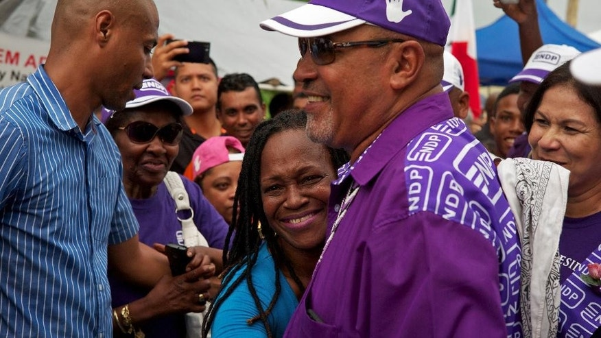 Suriname President Desi Bouterse greets supporters as he leaves a polling station, after casting his ballot in the general election, in Paramaribo, Suriname, Monday, May 25, 2015. Bouterse is betting that Monday's election to choose the South American country's next Parliament will keep him and his party in power for another five years. (AP Photo/Ertugrul Kilic)