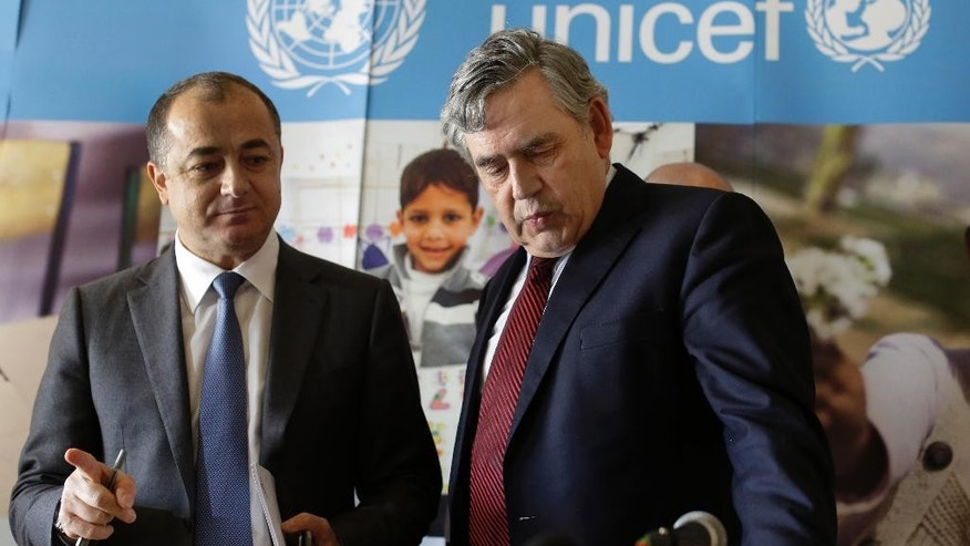 The United Nations Special Envoy for Global Education, former British Prime Minister Gordon Brown, right, shows the Lebanese Education Minister Elias Bou Saab his seat during their press conference in Beirut, Lebanon, Tuesday, May 26, 2015. Brown said Lebanon has made tremendous efforts, enrolling 106,000 Syrian children by introducing double shifts in more than 150 public schools but Syrian refugees have overwhelmed Lebanese public schools, which need more global support. Brown said he will help the Lebanese government raise $100 million before the beginning of the school year in August. (AP Photo/Hassan Ammar)