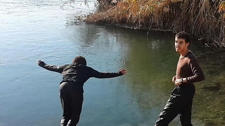 In this photo released on Sept. 29, 2014 by a militant website, which has been verified and is consistent with other AP reporting, two members of the Islamic State group spend time at the Euphrates river in Raqqa, Syria. Helping fighters marry, whether Syrians or foreigners, is a key priority for the Islamic State group. Aside from the stipend that fighters get, foreign fighters receive $500 when they marry, to help them put together their new household. (Militant website via AP)