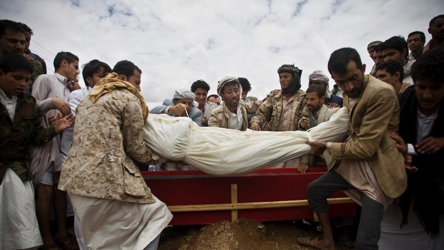 May 25, 2015: Shiite rebels known as Houthis bury a fellow Houthi who was killed in a Saudi-led airstrike during his funeral in Sanaa, Yemen.