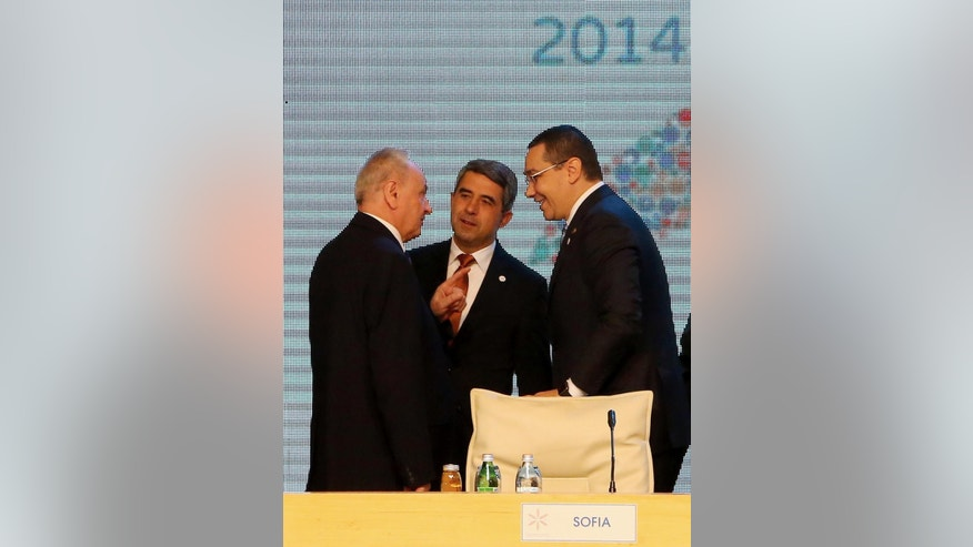 Moldovo President Nicolae Timofti, left, talks with Bulgarian President Rosen Plevneliev, center, and Romanian Prime Minister Victor Ponta in Tirana, Tuesday May 26, 2015, during the South East European Cooperation Process summit, a regional grouping of 13 Balkan and eastern European countries. Moldova's 4 million citizens would prefer to join the European Union rather than stay in the Russian orbit, its president said Tuesday. (AP Photo/Hektor Pustina)