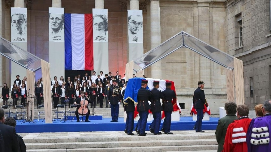The coffin of French resistance figure Jean Zay is carried by Republican Guards for a ceremony in the courtyard of the Sorbonne University in Paris, Tuesday, May 26, 2015. The event Tuesday is part of two days of national ceremonies honoring the two women and two men, meant to symbolize French efforts against extremist violence in the past and today, four months after deadly terrorist attacks. (AP Photo/Remy de la Mauviniere)