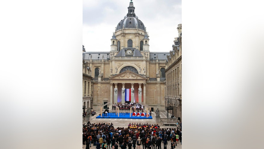 The coffins of French resistance figures Pierre Brossolette, Germaine Tillion, Genevieve de Gaulle-Anthonioz and Jean Zay are displayed for a ceremony in the courtyard of the Sorbonne University in Paris, Tuesday May 26, 2015. The event Tuesday is part of two days of national ceremonies honoring the two women and two men, meant to symbolize French efforts against extremist violence in the past and today, four months after deadly terrorist attacks. (AP Photo/Remy de la Mauviniere)