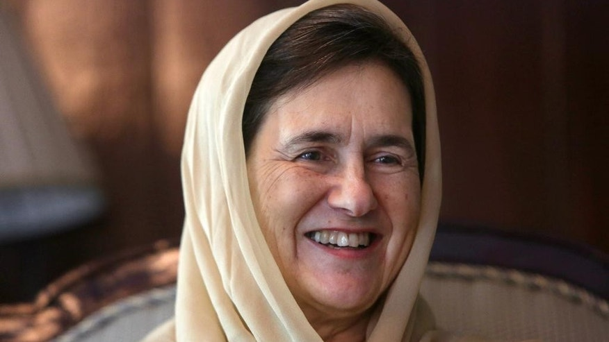 In this Monday, May 25, 2015 photo, Afghan  First Lady Rula Ghani smiles during an interview with The Associated Press at the presidential palace in Kabul, Afghanistan. Rula Ghani has been quietly breaking conventions since she became first lady in a society that traditionally keeps its women behind closed doors. In the eight months since her husband, President Ashraf Ghani, acknowledged her as his life partner in his inauguration speech, she has spoken out on a range of contentious issues violence against women, the rule of law and the power of religion. (AP Photo/Rahmat Gul)
