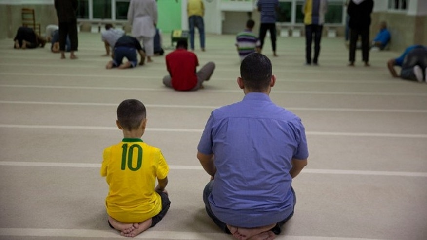 Syrian refugees attends prayer at a mosque in Sao Paulo, Brazil, Monday, May 25, 2015. Nearly 2,000 Syrians are trying to make a new life in Brazil, which has accepted more Syrians fleeing the violence at home than any other nation in the Americas with the exception of Canada. (AP Photo/Andre Penner)