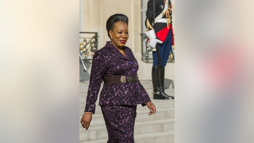 Central African interim president Catherine Samba-Panza leaves the Elysee Palace in Paris, France, after her meeting with French President Francois Hollande, Wednesday, May 27, 2015.  (AP Photo/Kamil Zihnioglu)
