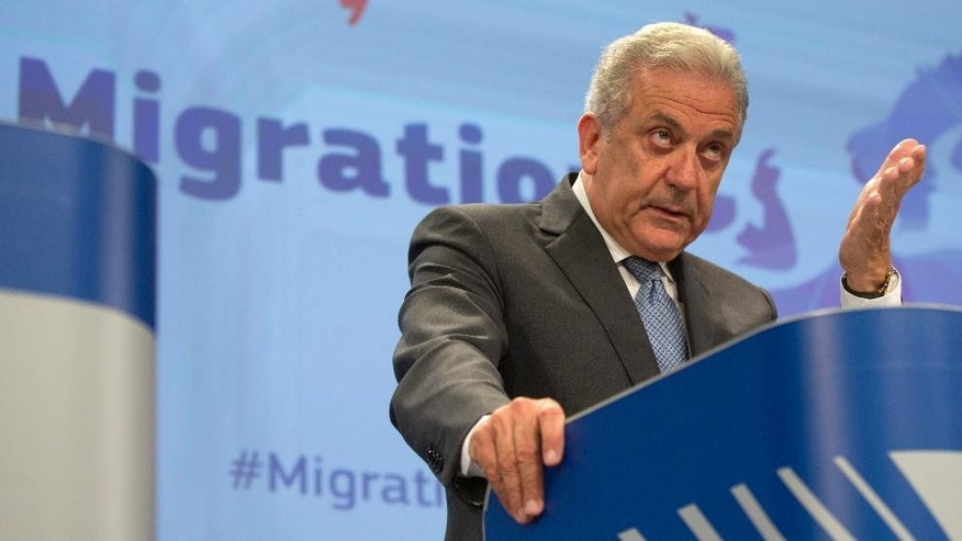 European Commissioner for Migration and Home Affairs Dimitris Avramopoulos speaks during a media conference at EU headquarters in Brussels on Wednesday, May 27, 2015. The EU moved Wednesday to help Italy and Greece manage a massive influx of migrants across the Mediterranean and oblige reluctant EU partners to share the refugee burden. (AP Photo/Virginia Mayo)