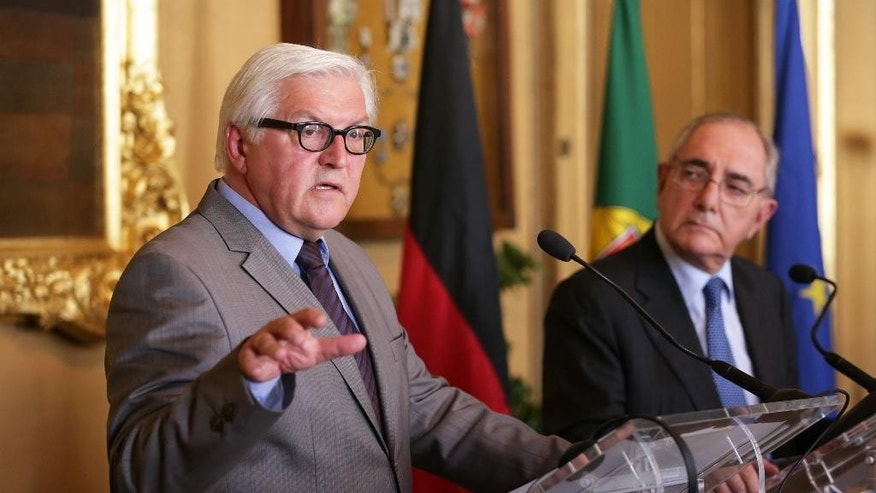 German Foreign Minister Frank-Walter Steinmeier, left, gestures during a joint news conference with his Portuguese counterpart Rui Machete following their meeting at Lisbon's Necessidades palace, the Portuguese foreign ministry, Wednesday, May 27, 2015. (AP Photo/Armando Franca)