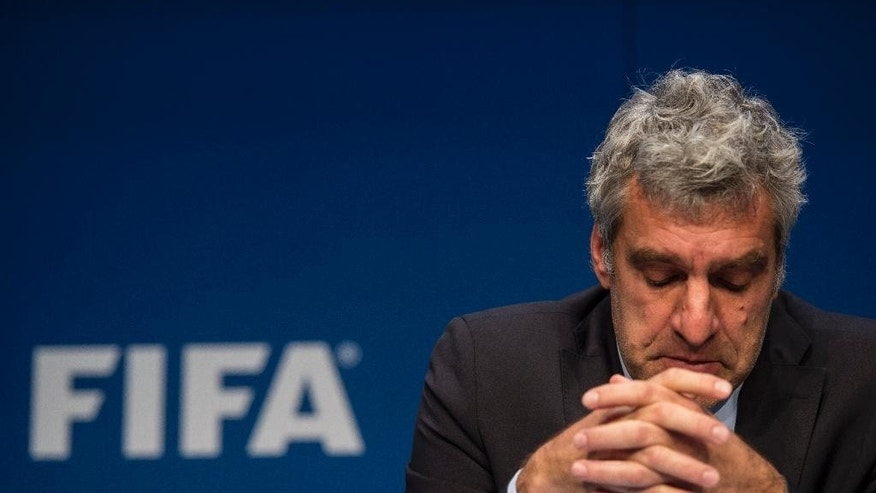 Walter De Gregorio, FIFA Director of Communications and Public Affairs, addresses the media during a press conference at the FIFA headquarters in Zurich, Switzerland, Wednesday, May 27, 2015. Swiss federal prosecutors opened criminal proceedings related to the awarding of the 2018 and 2022 World Cups, throwing FIFA deeper into crisis only hours after seven soccer officials were arrested and 14 indicted Wednesday in a separate U.S. corruption probe. (Ennio Leanza/Keystone via AP)