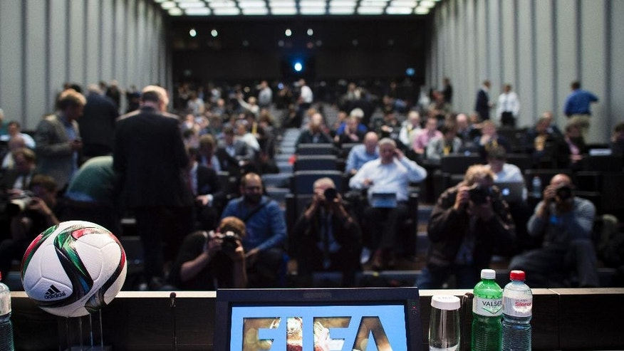 "Journalists gather for a press conference at the FIFA headquarters in Zurich, Switzerland, Wednesday morning, May 27, 2015. Swiss federal prosecutors say they have opened criminal proceedings related to the awarding of the 2018 and 2022 World Cups. The prosecutors' office says the proceedings are against ""persons unknown on suspicion of criminal mismanagement and of money laundering"" in connection with the votes won by Russia and Qatar. (Ennio Leanza/Keystone via AP)"
