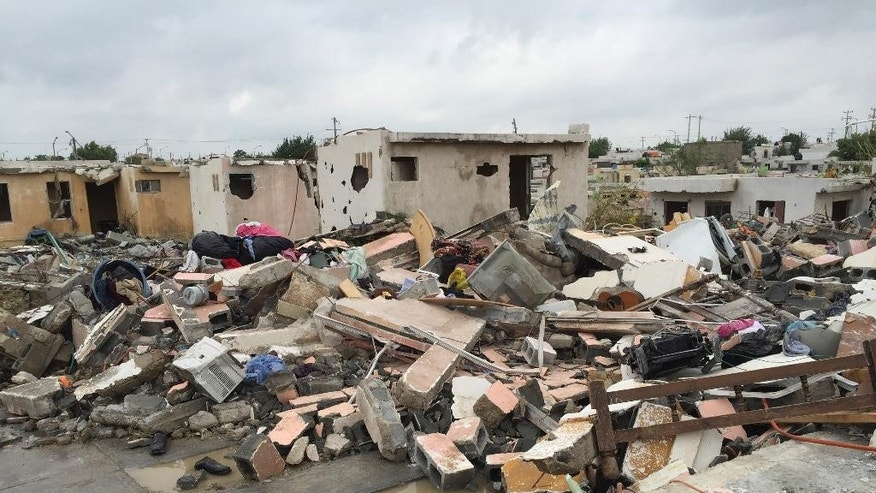 "Damaged homes stand next to others that were razed when a powerful tornado touched down in Ciudad Acuna, northern Mexico, Monday, May 25, 2015. The tornado raged through the city on the U.S.-Mexico border Monday, destroying homes and flinging cars like matchsticks. At least 13 people were killed, authorities said. The twister hit a seven-block area, which Victor Zamora, interior secretary of the northern state of Coahuila, described as ""devastated."" (AP Photo)"