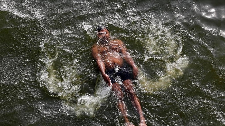 May 27, 2015: An Indian man swims in the River Yamuna on a hot summer day in Allahabad, India. Hundreds of people have died in southern India since the middle of April as soaring summer temperatures scorch the country, officials said Tuesday.