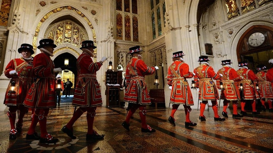"Yeoman of the Guard pass through the Peer's Lobby during the ceremonial search ahead of the State Opening of Parliament, in the House of Lords at the Palace of Westminster in London Wednesday May 27, 2015. After his surprise election victory, British Prime Minister David Cameron is laying out plans for government free of coalition compromises. Cameron says Wednesday's Queen's Speech will deliver a ""One Nation"" platform to unite the country, but opponents say the Conservatives' hard-line policies could weaken the United Kingdom and take it out of the European Union. (John Stillwell/Pool Photo via AP)"