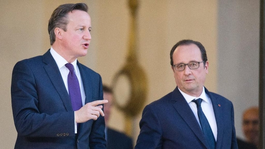Britain's Prime Minister David Cameron, left,  leaves with French President Francois Hollande, after their meeting, at the Elysee Palace in Paris, Thursday May 28, 2015. Cameron began two-day tour of European capitals on Thursday in a bid to secure EU reforms as his government published a law paving the way for a vote on whether Britain should leave. (AP Photo/Jacques Brinon)