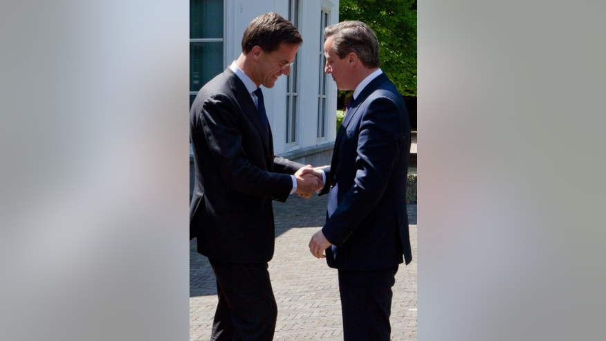 Dutch Prime Minister Mark Rutte, left, welcomes British Prime Minister David Cameron, right, upon his arrival at Catshuis residence prior to a meeting in The Hague, Netherlands, Thursday, May 28, 2015. Cameron met his Dutch counterpart on Thursday as he began a whirlwind visit to four European capitals, pressing his case that Britain needs to renegotiate its relationship with the 27 other members of the bloc. (AP Photo/Jan-Joseph Stok)