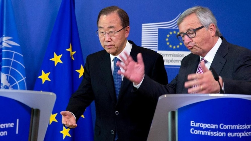 United Nations Secretary-General Ban Ki-moon, left, and European Commission President Jean-Claude Juncker participate in a media conference at EU headquarters in Brussels on Wednesday, May 27, 2015. The United Nations Secretary-General met with EU leaders and called for international solidarity to deal with the issue of tens of thousands of migrants crossing the Mediterranean in the hope of starting a better life in Europe. (AP Photo/Virginia Mayo)