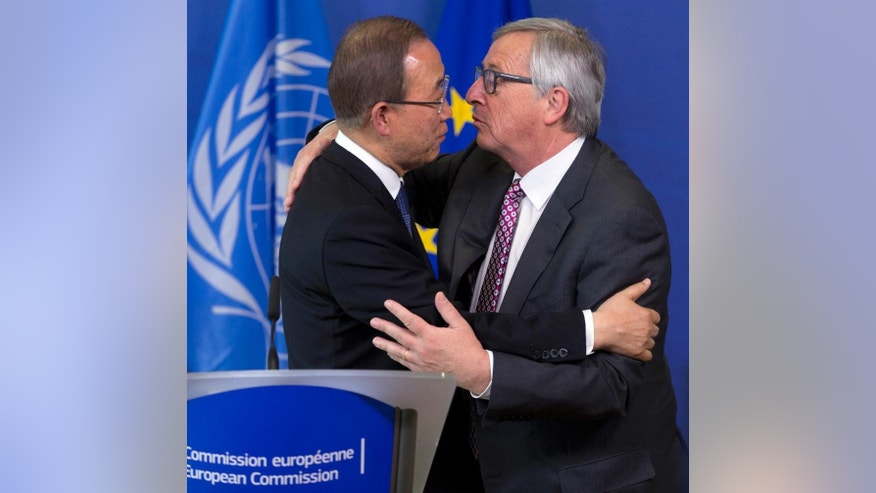 United Nations Secretary-General Ban Ki-moon, left, and European Commission President Jean-Claude Juncker greet each other during a media conference at EU headquarters in Brussels on Wednesday, May 27, 2015. The United Nations Secretary-General met with EU leaders and called for international solidarity to deal with the issue of tens of thousands of migrants crossing the Mediterranean in the hope of starting a better life in Europe. (AP Photo/Virginia Mayo)
