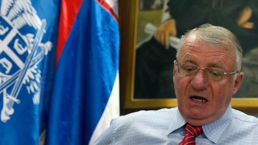 Serbian far right leader Vojislav Seselj speaks during an interview with The Associated Press, in Belgrade, Serbia, Thursday, May 28, 2015. Seselj says he will launch a legal battle before the Serbian courts to fight his pending extradition to the Yugoslav war crimes tribunal. (AP Photo/Darko Vojinovic)
