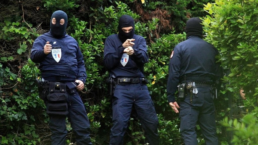 French police officers stand outside a villa during a search operation  in Biarritz, southwestern France, Thursday, May 28, 2015. French and Spanish authorities have detained one person and are raiding a villa in the French Atlantic coast city of Biarritz, in an operation targeting the Basque separatist group ETA. (AP Photo/Bob Edme)