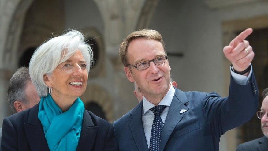 Jens Weidmann, president of the German Central Bank, talks to Christine Lagarde, Managing Director of International Monetary Fund, IWF, prior to a group photo session during the G7 Finance Ministers meeting in the Dresden Castle in Dresden, eastern Germany, Thursday, May 28, 2015. The G7 Finance Ministers meeting is being held in Dresden from May 27 to May 29, 2015. (AP Photo/Jens Meyer)