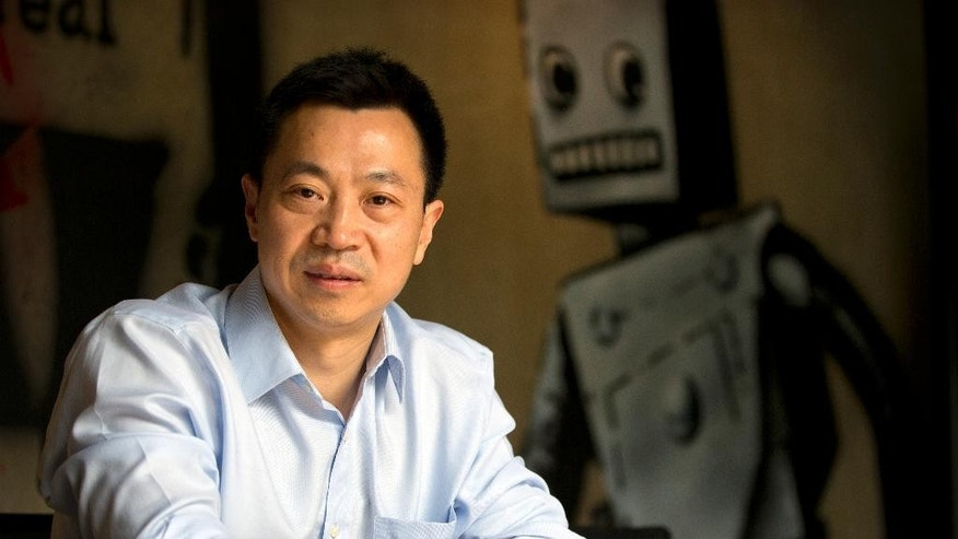 Chinese hotelier Wu Hai poses for a portrait in his office at his company's headquarters in Beijing Thursday, May 28, 2015. In the wee hours of a March morning, Wu posted an open letter to Premier Li Keqiang on social media criticizing government mistreatment of private businesses, but instead of an official reprimand, he received an unexpected invitation to China's central leadership compound to offer more of his thoughts. (AP Photo/Mark Schiefelbein)