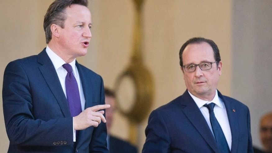 May 28, 2015: Britain's Prime Minister David Cameron, left,  leaves with French President Francois Hollande, after their meeting, at the Elysee Palace in Paris. (AP)