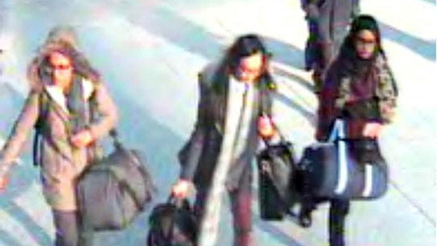 FILE -  In this still taken from CCTV issued by the Metropolitan Police in London on Feb. 23, 2015,  15-year-old Amira Abase, left,  Kadiza Sultana,16, center, and Shamima Begum, 15, walk through Gatwick airport, south of London, before catching their flight to Turkey on Tuesday Feb 17, 2015. The three teenage girls left the country in a suspected bid to travel to Syria to join the Islamic State extremist group. When the three British schoolgirls trundled across the Syrian border they were going to a place of no return. Only two of the approximately 600 Western girls and young women who have joined extremists in Syria are known to have made it out of the war zone. (AP Photo/Metropolitan Police, File) NO ARCHIVE