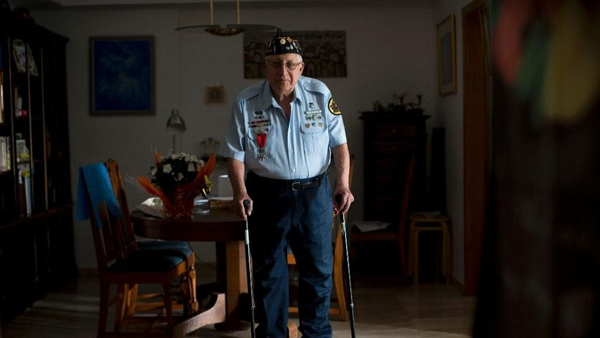 In this Tuesday, May 19, 2015 photo, U.S. Jewish World War II veteran Dan Nadel, who earned five battle stars leading combat engineer troops in the Battle of the Bulge and in the liberation of France, poses for a photo at his home in Jerusalem. Nadel is among a dwindling population of Jewish war veterans who battled the Nazis before immigrating to Israel -  a group that until recently received little recognition in the Jewish state. Seventy years after the war ended, Israel is finally paying homage to the 1.5 million Jewish soldiers who served their countries and their people in battle with a planned museum and research center. (AP Photo/Oded Balilty)