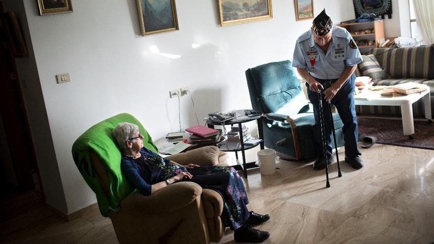 In this Tuesday, May 19, 2015 photo, U.S. Jewish World War II veteran Dan Nadel, right, who earned five battle stars leading combat engineer troops in the Battle of the Bulge and in the liberation of France, stands at his house in Jerusalem. Nadel is among a dwindling population of Jewish war veterans who battled the Nazis before immigrating to Israel - a group that until recently received little recognition in the Jewish state. Seventy years after the war ended, Israel is finally paying homage to the 1.5 million Jewish soldiers who served their countries and their people in battle with a planned museum and research center. (AP Photo/Oded Balilty)
