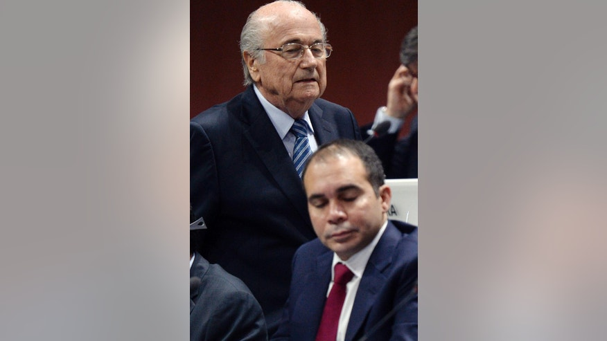 FIFA president Joseph S. Blatter, left, walks past Prince Ali bin al-Hussein, right, during the 65th FIFA Congress held at the Hallenstadion in Zurich, Switzerland, Friday, May 29, 2015, where Blatter runs for re-election. (Walter Bieri/Keystone via AP)