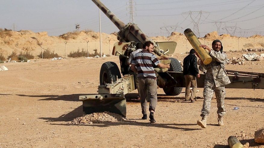 March 19, 2015 - FILE photo of Libya Dawn fighters preparing to fire an artillery cannon at ISIS militants near Sirte, Libya. Libya's ISIS affiliate took control of a civilian air base in Sirte Friday, after months of fighting.