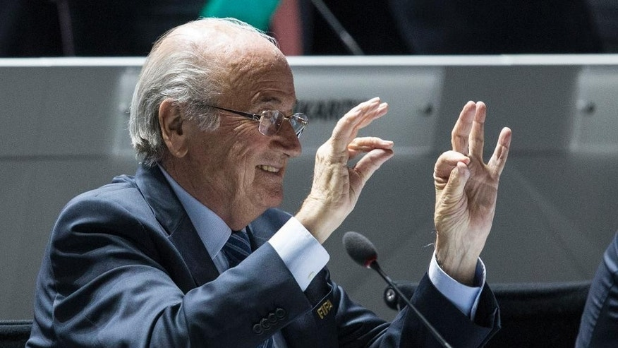 FIFA president Joseph S. Blatter makes a gesture during the 65th FIFA Congress held at the Hallenstadion in Zurich, Switzerland, Friday, May 29, 2015 where he runs for re-election as FIFA head. (Patrick B. Kraemer/Keystone via AP)