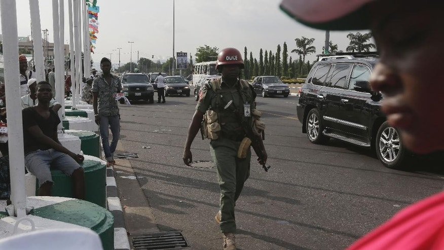 A police officer patrols outside Eagle Square, a day ahead of the Presidential Inauguration of former General and Nigerian President elect Muhammadu Buhari, in Abuja , Nigeria, Thursday, May 28, 2015. (AP Photo/Sunday Alamba)