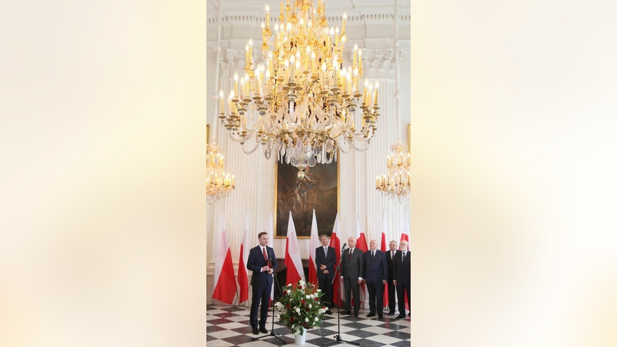 Poland's President-elect Andrzej Duda, left, attends a state ceremony confirming his electoral win at the Wilanow Palace in Warsaw, Poland, on Friday, May 29, 2015. A member of the conservative Law and Justice party, Duda, a 43-year-old lawyer, ousted President Bronislaw Komorowski in May 24 runoff, in an outcome that is seen as a warning to the establishment of public discontent with course of events in Poland.(AP Photo/Czarek Sokolowski)