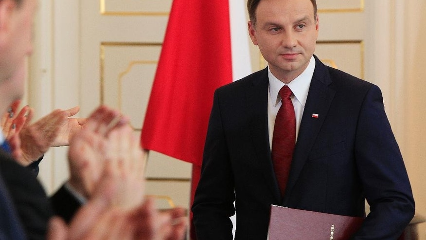 Poland's President-elect Andrzej Duda attends a state ceremony confirming his electoral win at the Wilanow Palace in Warsaw, Poland, on Friday, May 29, 2015. A member of the conservative Law and Justice party, Duda, a 43-year-old lawyer, ousted President Bronislaw Komorowski in May 24 runoff, in an outcome that is seen as a warning to the establishment of public discontent with course of events in Poland. (AP Photo/Czarek Sokolowski)