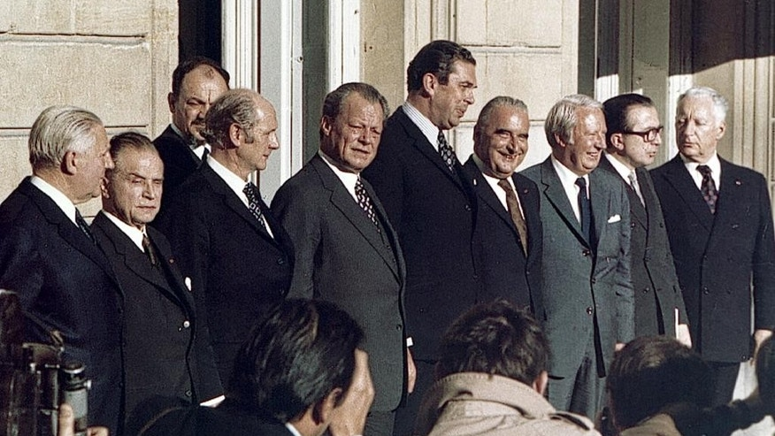 "FILE - In this Oct. 19, 1972 file photo, European leaders pose for a photograph, at the European Common Market summit conference, with French President Georges Pompidou fourth from right stands next to Britain's Prime Minister Edward Heath, third from right, at an Elysee Palace luncheon, in Paris. Britain finally joined the ""common market' at the start of 1973 after Heath managed to douse concerns in Europe. Britain's cause was helped by the resignation of French President Charles de Gaulle in 1969. His successor Pompidou proved far more amenable to Britain's membership. (AP Photo/Michel Lipchitz, File)"