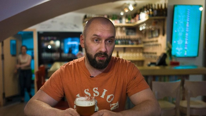 In this photo taken on Friday, May  22, 2015,  Stanislav Obraztsov speaks to The Associated Press about the weak ruble at his craft beer bar in Moscow. The ruble's crash in value against the dollar last year helped Russia's nascent craft beer industry by making imported competitors more expensive. (AP Photo/Alexander Zemlianichenko)