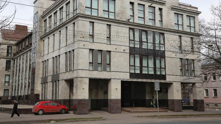 "In this picture taken on Sunday, April 19, 2015,  a women enters the four-story building known as the ""troll factory""  in St. Petersburg, Russia. The ""troll factory"" is where hundreds of young Russians work around the clock writing blogs and posting comments on the Internet staunchly supporting President Vladimir Putin and attacking the West. (AP Photo/Dmitry Lovetsky)"