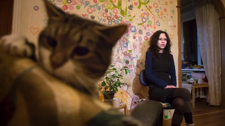 In this picture taken on Wednesday, April 15, 2015, Lyudmila Savchuk speaks in an interview in her apartment in St. Petersburg, Russia. Lyuda Savchuk, a single mother with two children, was once a Kremlin troll working as part of an immense propaganda machine trying to shape public opinion not only across Russia but also in the United States and Europe. (AP Photo/Dmitry Lovetsky)