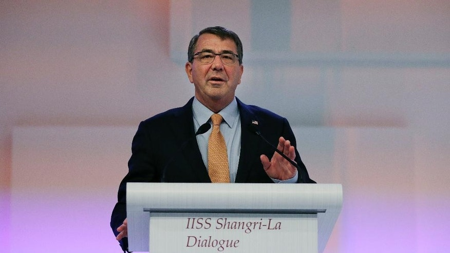 "U.S. Secretary of Defense Ashton Carter delivers his speech about ""The United States and Challenges to Asia-Pacific Security"" during the 14th International Institute for Strategic Studies Shangri-la Dialogue (IISS) Asia Security Summit, Saturday, May 30, 2015, in Singapore. (AP Photo/Wong Maye-E)"