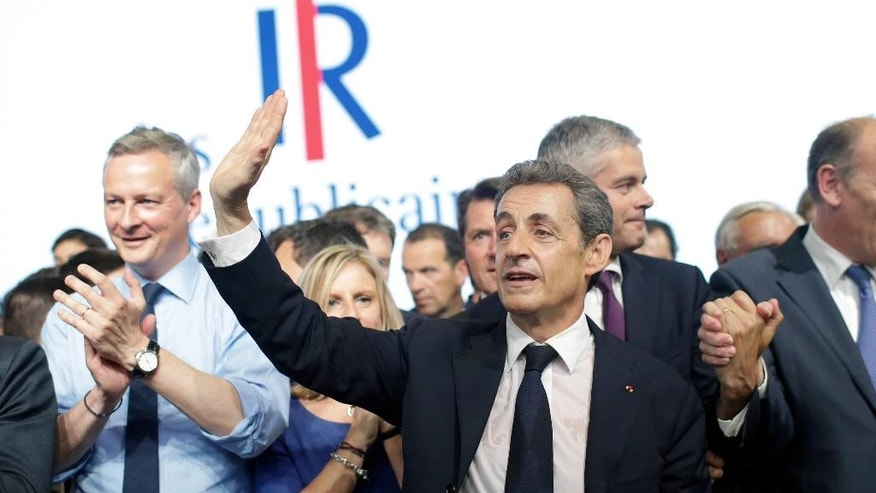 "Former French President Nicolas Sarkozy, leader of opposition right-wing party formerly known as the ""UMP"", waves after delivering a speech during the party congress to mark the foundation of the movement ""Les Republicains"" (The Republicans), in Paris, Saturday, May 30, 2015.  The UMP (union for a popular movement) on Saturday officially changed its name to ""the Republicans"" after a two-day vote by members.   (AP Photo/Thibault Camus)"