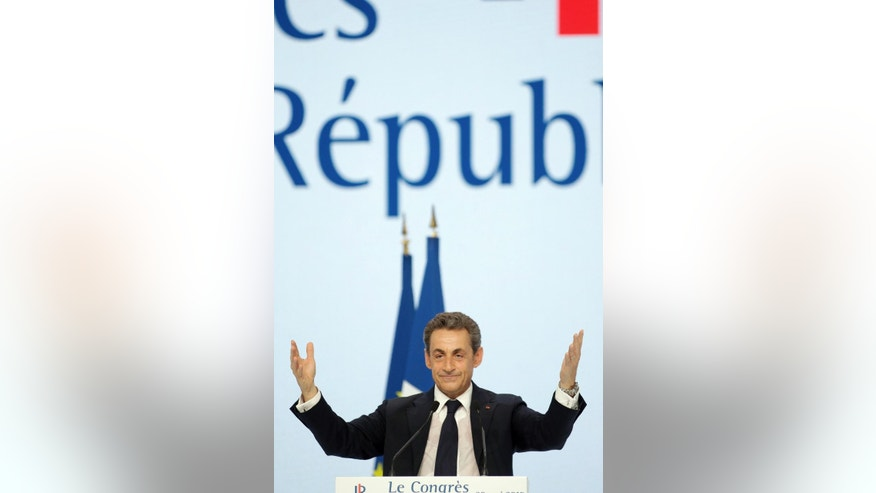 "Former French President Nicolas Sarkozy, leader of opposition right-wing party formerly known as the ""UMP"",  delivers a speech during the party congress to mark the foundation of the movement ""Les Republicains"" (The Republicans), in Paris, Saturday, May 30, 2015.  The UMP (union for a popular movement) on Saturday officially changed its name to ""the Republicans"" after a two-day vote by members. (AP Photo/Thibault Camus)"