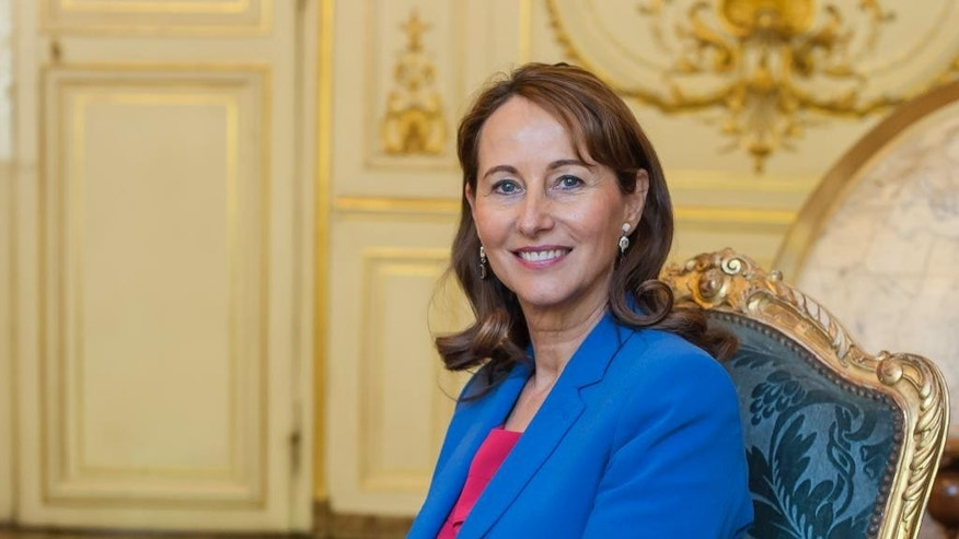 France's influential Environment Minister Segolene Royal poses for a photographs during an interview with The Associated Press in Paris, France, Friday, May 30, 2015.  Longtime former partner of French President Francois Hollande,  Royal says climate change threatens global security, adopting an unusually hawkish stance as she heads to the U.S. next week to seek support for a global climate accord. (AP Photo/Kamil Zihnioglu)