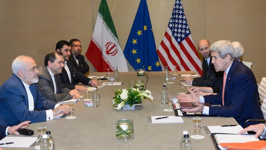 U.S. Secretary of State John Kerry, right, speaks with Iranian Foreign Minister Mohammad Javad Zarif, left,  prior to a bilateral meeting for a new round of Nuclear Talks with Iran  at the Intercontinental Hotel, in Geneva, Switzerland, Saturday, May 30, 2015. A month out from a nuclear deal deadline, the top U.S. and Iranian diplomats gathered in Geneva Saturday in an effort to bridge differences over how quickly to ease economic sanctions on Tehran and how significantly the Iranians must open up military facilities to international inspections. (Laurent Gillieron/Keystone via AP)