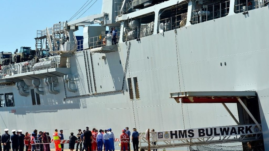 Migrants disembark from the British Naval ship HMS Bulwark at the Taranto harbor, Italy, Saturday, May 30, 2015.  (AP Photo/Gaetano Lo Porto)