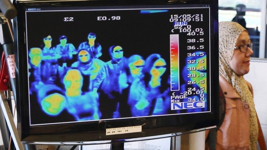 May 21, 2015: A thermal camera monitor shows the body temperature of passengers arriving from overseas against possible MERS, Middle East Respiratory Syndrome, virus at the Incheon International Airport in Incheon, South Korea.