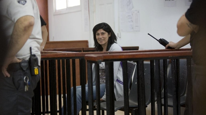 FILE - In this Thursday, May 21, 2015 file photo, Palestinian Parliament member Khalida Jarrar of the Popular Front for the Liberation of Palestine attends a court session charged with inciting violence, at the Israeli Ofer military base near the West Bank city of Ramallah. A lawyer for Jarrar says a military court has rejected an order to release her on bail and a court said she must remain behind bars until her trial on June 22. (AP Photo/Majdi Mohammed, File)